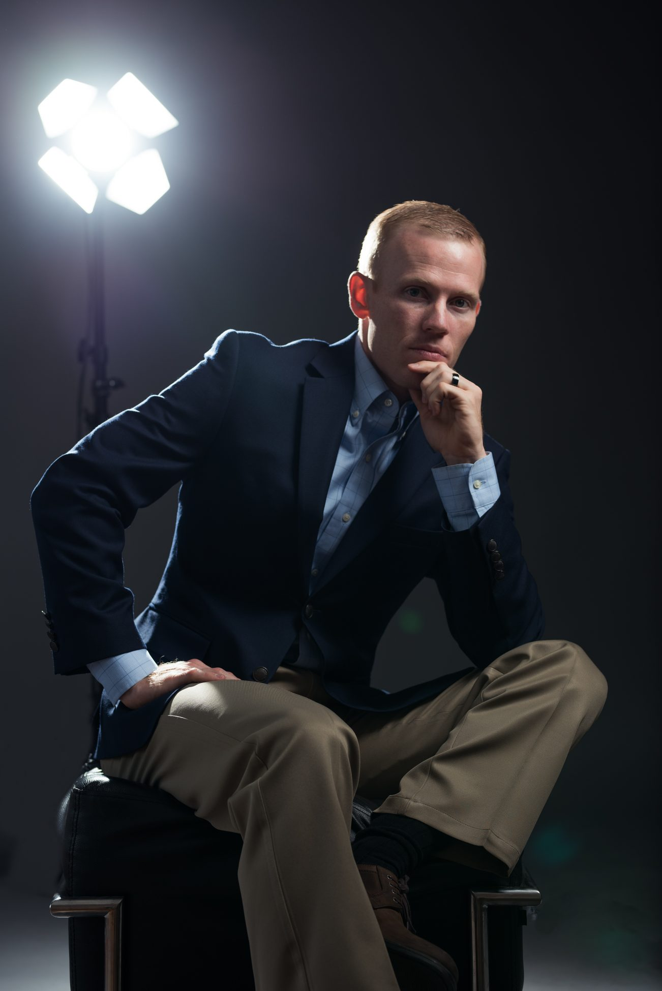 Business portrait with dramatic lighting by Utah photographer Purple Moss