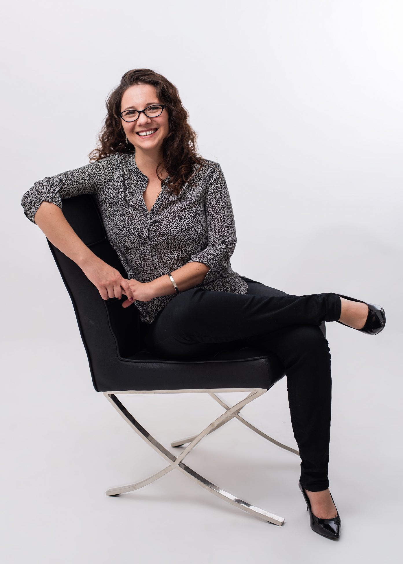 Seated business portrait of a woman by Salt Lake City photographer Purple Moss