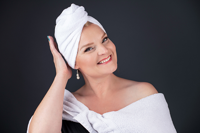 Branding portrait of woman with towel on her head.